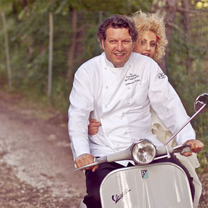 Wedding in Umbria Vespa Club. The Chef Giancarlo Polito in Vespa with the bride. Montone, Perugia, Umbria, Italy